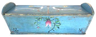 F730 Early 19th Century Lancaster, Pennsylvania hand painted and Folk Art decorated dovetailed dough box. Opposite ends are decorated with hand painted inscribed hearts...one end says �me�, the other end says �you�. The top is decorated with hand painted birds, vines and flowers. The sides are decorated with hand painted flowers and vines. Measurements are: 36 3/4� long x 14� deep x 10 1/4� tall (sides) x 13� tall (ends)