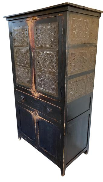 G16 19th century.,18 tin  tall Pie Safe In old black paint , The upper case having a single board top surface, and eighteen hand  punched tins panels, the side of the Pie safe has a larger tin with a smaller tin , the two upper  doors has three tins , on each door that opening to a three shelf interior, old natural patina nice and clean, over a single full width dovetailed drawer with wooden pulls, the two doors in the bottom are  paneled, the  lower case opening to a two shelf interior, all rising on square legs; Measurements are 42 ¼� wide top  x 38 ¾� case  x 23 ¾ including molding 21� deep x  72 ¾� tall