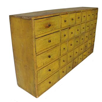 "C481 19th century,Pennsylvania  Forty  drawer Apothecary Chest with the original yellow paint. very unusual drawer lay out, with five larger drawers on the left side, the drawers, and case  are nailed construction, the wood is white pine, circa 1880  Measurements are 291/2"" tall . 55""wide . 12""deep."