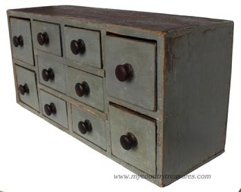 D140 19th century Lancaster Pennsylvania 10 drawer apothecary chest, circa 1850 with the original gray painted case ,very unusual drawer lay out, with two large drawers on each end, with six smaller drawers in the middle. The stretchers are mortised into the case, all original knobs square head ail construction great size.