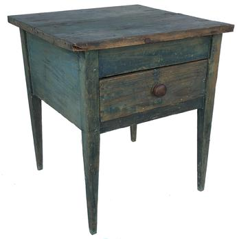 E498 Southern 19th Century North Carolina oversized country one drawer stand retaining a old blue painted surface, very unusual form with the large apron and  smaller drawer.