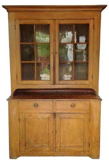 A160 Early 19th century Pennsylvania Lancaster Co. two part painted pine Dutch Cupboard, the upper srection with a wide cornice above two glazed doors, with original old wavie glass, resting on a base with two dovetailed drawers above two paneled door. Retaining it's original decorated surface