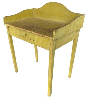 "F753  Early 19th century New England Server in old yellow paint, high arched applied  gallery, resting on four tapered hepplewhite legs, the wood is white pine all square head nail construction, with a single nailed drawer. circa 1830 Measurements are"" 30 3/4"" wide x 36 1/2"" tall x 19 1/2"" deep"