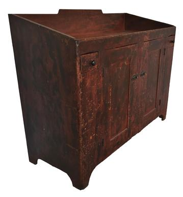 "D266 Early 19th century Pennsylvania open well   pine drysink, retain it original  red paint with black dections ,paint decorated surface., with two small dovetailed drawers on each side , solid end with a simple cut out foot, 38"" h., 48"" w., 18 1/4"" d."