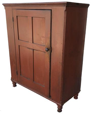 LD1  Early 19th century Lancaster County Milk Cupboard, with original dry red paint, dovetailed case top and bottom, single door with four nice champhered panels,mortied and pegged, with the original red paint inside of the door.. Lamb tongue corner, with the original mushroom turned knob, beautiful turned feet.circa 1800- 1820