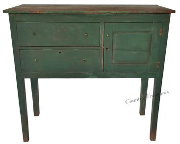 "D311 19th century Southern Huntboard from Johnson City, North Carolina in old green over the original red paint.  Circa 1840, very unusual form, with two dovetailed  drawers and door  configuration. Chafuer paneled ends, as well as the back.The case is pegged and squared head nail  construction, the wood is heart pine and poplar, This Huntboard retains all it's original  brass hardware.Measurements are: 40"" tall x long X 19 1/2"" deep"