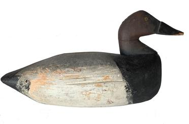 "E323 Early 1940""s oversized Canvasback Drake North Carolina , it has the letter T.B. stamped in the lead weight on bottom of Decoy. early working repaint with a lot of the original paint showing. small dog chew on bill as found condition Measurements are: 16"" long x8"" wide"