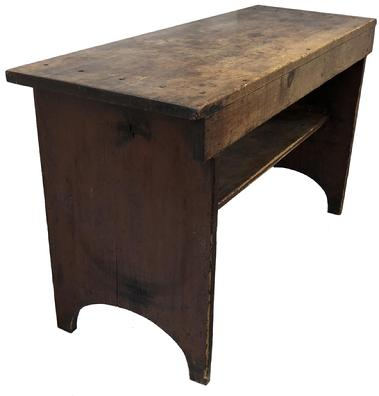 "E314 Early 19th century Lancaster County Pennsylvania, Bucket bench, retaining it's original dry red paint surface. Very unusual form, having a 3/4 shelf below, high arched cut out ends, one board white pine square head nail construction. circa 1820  Measurement 50 1/4"" wide x 18"" deep x 28"" tall"