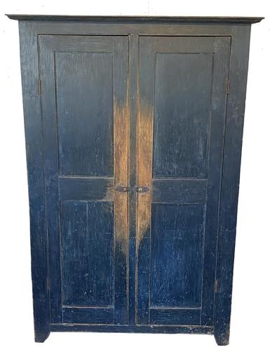 Phenomenal two door storage cupboard in stunning, original, dry, dark indigo-blue paint.   Doors are fully mortised and pegged. The deep top molding is also pegged.  There is a fine beaded edge around each of the doors and half moon cut out on each end.  Clean inside with four interior shelves. Measurements:  67 1/4� tall � Case is 42 1/4� wide x 16 1/4� deep � Top Molding is 46� wide x 18� deep