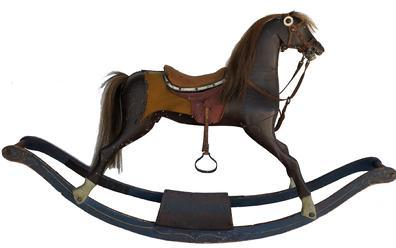 E432 19th century American carved Rocking Horse on bow rocker , with original blue rockers with mustard decoration, and brown wooden body, leather sadder with horse hair mane and tail