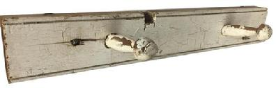 D416 Late 18th century Pennslyvania Peg Rack with two pegges in old dry white painted surface, circa 1790