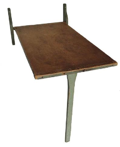 "C426 19th century New England fold down wall mounted work table,  wooden hinged with a swing down leg, one board with bread board ends, with the original green paint,  circa 1830  Measurements are:37"" long x 28 1/2"" wide  when it is folded down it  is 30"" tall"
