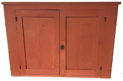 VD396 Mid 19th century Pennsylvania two door pine Hanging Corner Cupboard, with the original red paint, doors are chamfered inside, the interior is natural patina, circa 1840