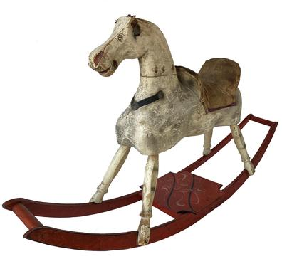 "19th century hand made wooden Rocking Horse in it's original paint showing wonderful wear from lots of love, the rockers are painted red with a black and mustard decorated platform. Early in the 19th century, woodworkers, most from New England, started making more sculptural horses. ""These were hand-made, ""It was Dad in the woodshop cranking out the first ones. . While almost always made of wood, some were padded and others had leather or cloth saddles and reins, features that have often been lost to time."