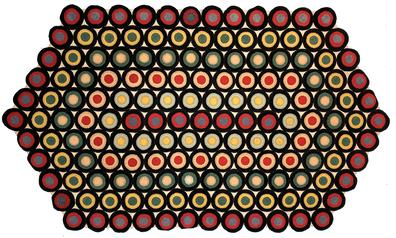 F533  PENNY RUG.   late 19th century American Pennsylvania penny rug. Six sides of circular medallions stitched together in colors of red black and mustad green. All edged in i-circles. The rug has been professionly mounted on fram and ready to hang