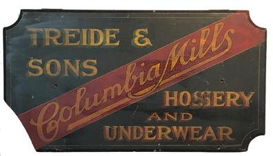 "F68 Late 19th Century wooden trade sign from Baltimore, Maryland for Treide & Sons Columbia Mills Hosiery and Underwear.  The sign is painted on single board, with a black background and red, green and mustard lettering.  Treide & Sons was founded in 1869 and was located at the S E corner of Hopkins Place and German Street in Baltimore. Measurements are: 36"" wide x 20"" tall"