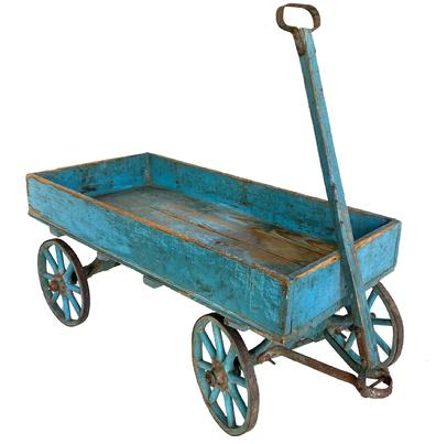 F750 AMERICAN CHILD'S PAINTED WOOD WAGON Child's wooden original robin egg blue painted  wagon, late 19th or early 20th century, with forged iron rims, pull handle, low-sided box-like bed,hinged tongue, and four wooden-spoke wheels. Original worn painted surface.