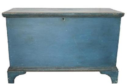 "E206 EARLY 19TH CENTURY  BLUE PAINTED PINE PENNSYLVANIA  BLANKET CHEST, This is a wonderful early 19th Century painted blanket chest from South eastern Pennsylvania,  with  ORIGINAL  blue paint.  The surface undisturbed, the exterior of the case crafted of six broad planks of Eastern White Pine, the sides and bottom joined with exposed dovetail construction.  The base is affixed with  small nails  and the feet are delicate little brackets with molding around the top is affixed with pegs set at regular intervals, the lid lifting on original wrought iron strap hinges dovetailing to the front and sides .measurements:  37 1/2"" W x 213/4"" D x 23 3/4"" H"