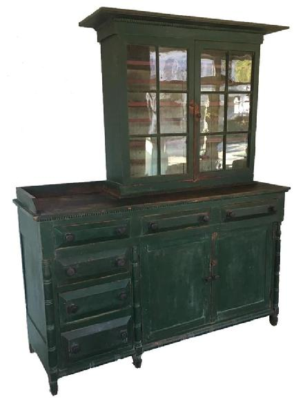E358 Striking Southern Wythe County, Virginia Stepback / Server. This is one of two known examples in this rare form, having offset drawers on one side with a work surface, and a traditional Stepback on other side. The exterior of this two-piece cupboard retains an old green paint over the original red, the interior is an oyster white. All square nail construction with outstanding beveled drawer fronts and deep chamfered door panels, side panels and back boards. Made of Cherry and Poplar woods. There are very unusual turned quarter-round moldings applied to areas on both top and bottom of this cupboard showing the cabinetmaker's skills. The very simple turned half-round columns and also a turned half-round base molding adds to the exquisite details of this piece. This rare