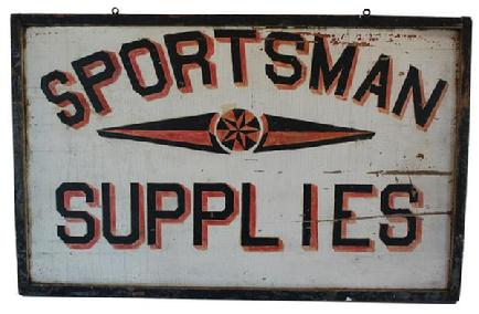B104 Trade Sign circa 1930's for sportsman supplies with painted black lettering having red and yellow shadows and a central star motif