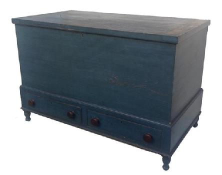 "Y330 Early 19th century Pennsylvania Blanket Chest, resting  on a frame, with  a small turned leg, molded top and bottom of frame, two dovetailed drawers, an a blind dovetailed case, all original with wonderful dry blue paint,with a small turned leg. With a lid support, for hold open the lid circa 1820 - 1830  Measurements are 23 1/2"" deep x 42 1/2"" wide x 29"" tall"