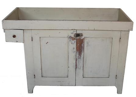 C436 19th century York Pennsylvania over hanging drawer Drysink, in the dry original oyster white paint, high cut out foot, retains the old natural patina on the interior. one board well, with tapered sided. one board bottom, the drawers is square head nailed. circ 1860