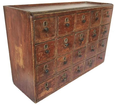 "SP4 19th century  Pennslyvaia twenty drawer Apothecary, in original paint, each drawers has a lock,  the drawers are nailed construction, with square head nails, the top of the Apothecary has a small gallery, circa 1840's   Measurements are 26 1/2"" wide x 17 1/2"" tall x  9 1/2"" deep"