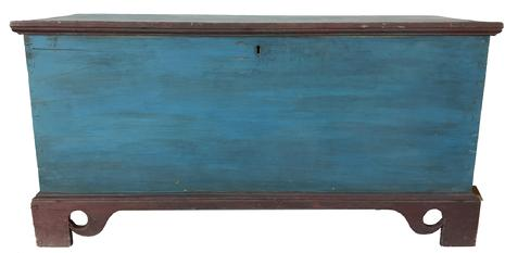 "D555 19th century Salisbury Maryland in the original red and blue paint, dovetailed case with applied elaborate cut out base. One board square head nail construction, the interior has a locking glove box. circa 1830 Measurements are 45"" wide x 22 1/2"" tall x 17 1/2"" deep"