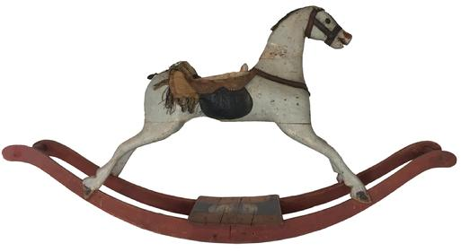 D385 Early 19th century American  bow rocker,  Rocking Horse ,  realistically carved and painted,  This rocking horse has a  gallop posture with  legs dovetailed into the body,.These were called bow rockers