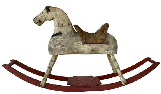 "F170  19th century hand made wooden Rocking Horse in it's original paint showing wonderful wear from lots of love, the rockers are painted red with a black and mustard decorated platform. Early in the 19th century, woodworkers, most from New England, started making more sculptural horses. ""These were hand-made, ""It was Dad in the woodshop cranking out the first ones. . While almost always made of wood, some were padded and others had leather or cloth saddles and reins, features that have often been lost to time. Measurements are: 46"" long x 10 1/2"" wide x 25"" tall"