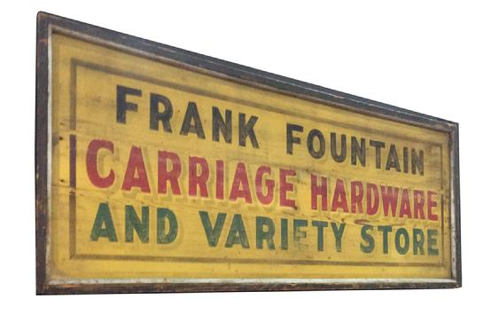 "C520 Late 19th century Trade Sign from upstate New York, Frank Fountain Carriages and Hardware , painted on board, with applied molding, great colors of yellow back ground with black, red and green, lettering Measurements are: 24"" tall and 62"" long"