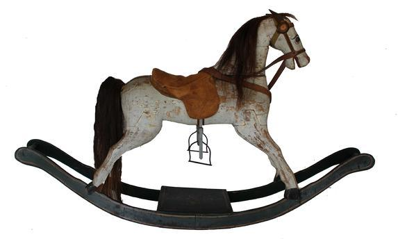 B597 Late 19th century bow rocker Rocking Horse , was realistically carved and painted, in a variety of sizes and styles, often with a mane and tail of real horsehair This rocking horse legs attached at the hooves to curving struts that formed the rockers.