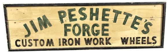 "E77 Early 20th century trade sign "" Jim Peshette's forge custome iron work and wheels"",advertise early iron wheels for Model T's and wagon's , painted on board with applied molding one sided , black letter on a off white back ground. Found in Pa purcased from a private sign collection"