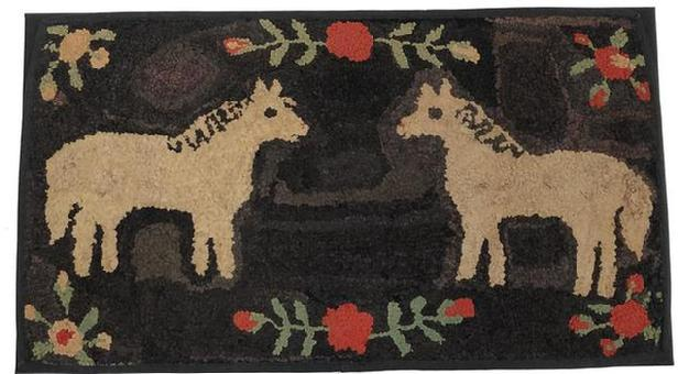 C551 Late 19th century Double-Horse Hooked Rug, Pennsylvania , it is rare and desirable to see two horses on the same rug. The standing pose is further energized by the striated black back ground, with red and white flowers with green leaves ,