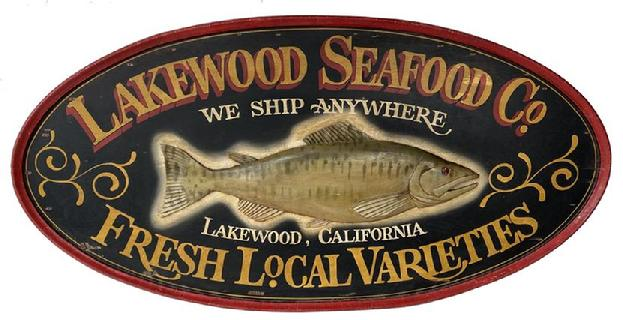 "F151 Early 20th century beautiful wooden Double Sided Seafood Co. Hanging Wood Advertising Sign. Large oval double sided sign centered with a relief carved fish and reads ""Lakewood Seafood Co., We Ship Anywhere, Fresh Local Varieties, Lakewood, California"". Very nice overall condition"