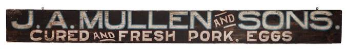 "E215 ""J.A. MULLEN AND SONS. / CURED AND FRESH PORK. EGGS."" against a black ground,  original surface with hanging hooks. Circa 1920. 7 1/2"" x 74""."