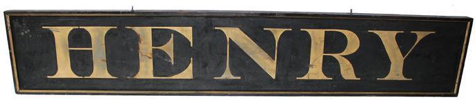 "D120 Mid 19th century wooden trade sign for ""HENRY"" this sign is one board with the original black and gold gilt paint. It has applied molding in wonderful condition, From the collection Henry Fleckenstein, who was a well know decoy authority and Author of several Decoy Books. Mr Fleckenstein used this sign in his booth when he did Decoy shows and displays, circa 1850-1860"