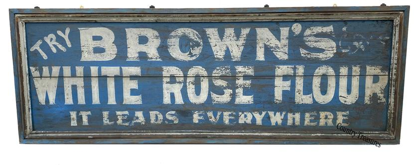 F694 Wonderful Berks County, Pennsylvania wooden sign that reads: �Try Brown�s White Rose Flour   It Leads Everywhere� Sign bears its original blue and white paint and applied molding. Information from internet  FM Brown & Sons, Inc. - Berks Co. - Pennsylvania - 1895, they were producing Pantry White Rose Flour.  Measurements: 74� wide x 26� tall x 2� deep