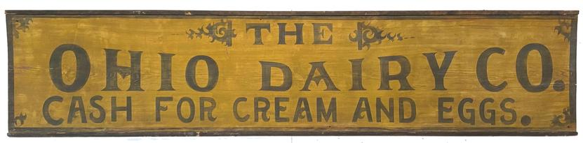 "G33 Trade Sign wooden one sided beautiful mustard painted back ground with black lettering painted on one wide board with applied molding, for Ohio Dairy Co, cash for cream and Eggs. Measuremens are 23 1/2"" tall  x 105"" Long"